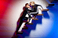 Latex girl and boy. Girl and boy in the latex on the stairs Royalty Free Stock Photo