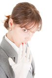 Latex glove and teeth. Portrait of business woman, lifting latex glove with teeth Stock Image