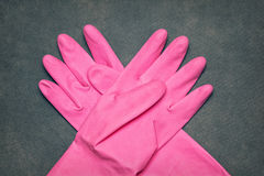 Latex gloves for cleaning. Latex pink gloves for cleaning royalty free stock image