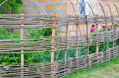 Lath fence around a farmer's house in Ukraine Stock Photo