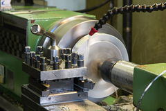 Lathe. Milling and machining of material to lathe stock photography