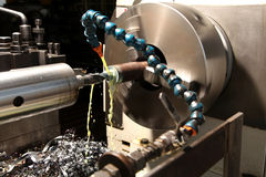 Lathe. Drilling a hole on a lathe with steel shavings underneath stock photography