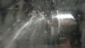Lathe in action closeup. Splashes of water. Cnc machine coolant stock video footage