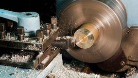 Lathe in action. Processing brass billet. stock image