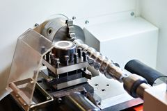 Lathe with cutters and workpiece Stock Photos