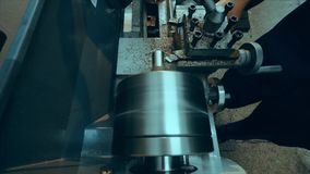 Lathe is cutting metal. High speed cut. Lathe work stock footage