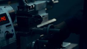 Lathe is cutting metal. High speed cut. Lathe work stock footage