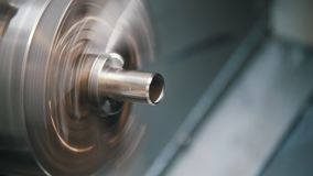 Lathe drill the thread and rounds the edges of the part. Close up stock video