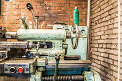 Lathe in factory. Retro old lathe in factory Royalty Free Stock Photography