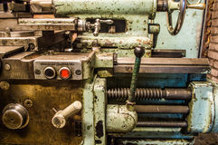 Lathe in factory. Retro old lathe in factory Stock Image