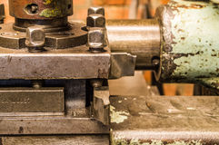 Lathe in factory. Retro old lathe in factory Royalty Free Stock Images