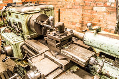 Lathe in factory. Retro old lathe in factory Stock Images