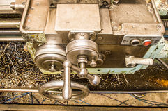 Lathe in factory. Retro old lathe in factory Stock Photography