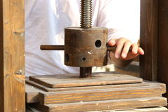 Lathe with the grip for the artisan processing of paper Stock Images