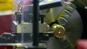 Lathe machine in action, super slow motion. Machining brass piece 250 fps close up shot