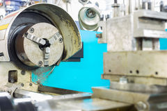 Lathe machine for cutting work and finished work Royalty Free Stock Image