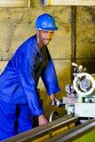Lathe machine operator. African american lathe machine operator operating lathe machine in the workshop Stock Image