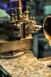 Lathe machine in a workshop, Part of the lathe. Lathe machine is operation on the work shop Royalty Free Stock Images