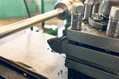 Lathe tool on a background of a cylindrical part in the machine tool. Lathe tool on a background of a cylindrical part in the machine tool royalty free stock photos