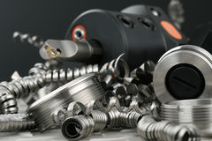 Lathe tool and turnings Stock Photo