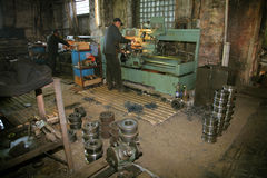 Lathe and the turner. At a machine-building factory Stock Photography
