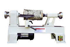 Lathe with wooden workpiece. Isolated Royalty Free Stock Photo