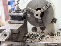 The lathe in work. Turning lathe in the workshop, close up detail Royalty Free Stock Photos