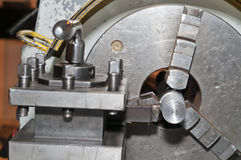 The lathe in work. Turning lathe in the workshop, close up detail Stock Images