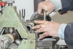 Lathe worker (Handicap workers) Royalty Free Stock Photos