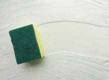 Lathered the sponge washes the soap surface. Abstract simple background, the backdrop of the subject of cleaning. White, light shades. Top view. Close-up stock illustration