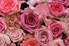 Lathyrus and roses in a wedding bouquet. Lathyrus and roses in a pink wedding arrangement Royalty Free Stock Photography