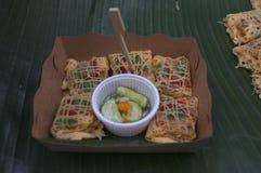 Latieng ou Fried Prawns & porca envolvido em uma rede do ovo, alimento do conceito, partido Imagem de Stock