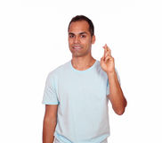 Latin adult man crossing his fingers Royalty Free Stock Image