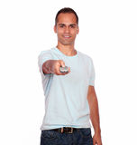 Latin adult man pointing with remote control Royalty Free Stock Images