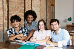 Latin and african american business team of young people. At modern office of start up enterprise royalty free stock image