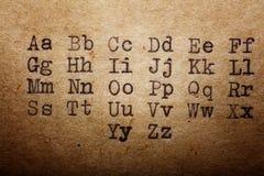 Latin alphabet font printed on vintage Stock Photo