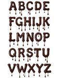 Latin alphabet made of melted chocolate with drops vector illustration