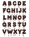 Latin alphabet made of melted chocolate with falling drops in high resolution royalty free stock photo