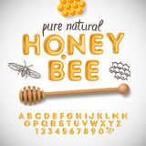 Latin alphabet and numbers made of honey Stock Photography