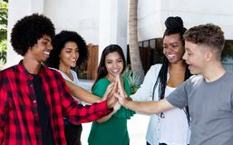 Latin american and african team of young adults. In the city stock images