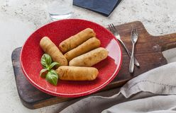 Tequenos made of fried corn filled with cheese royalty free stock photos