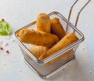 Tequenos made of fried corn filled with cheese stock photo