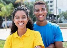 Latin american couple with colorful shirts Royalty Free Stock Image