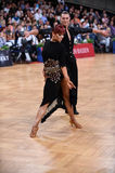 Latin american couple dancing at the competition Stock Images