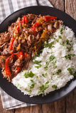 Latin American cuisine: ropa vieja with rice close-up.  Royalty Free Stock Image