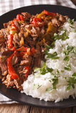 Latin American cuisine: ropa vieja with rice close-up. vertical Royalty Free Stock Photography