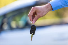 Latin american driver holding car keys driving his new car Royalty Free Stock Images