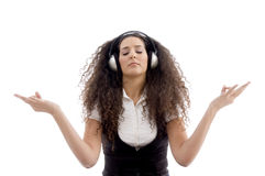 Latin american female enjoying music. On an isolated white background Stock Photos