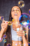 The Latin American female with soap bubbles Stock Photography
