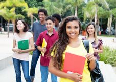 Latin american female student with group of international studen Stock Photography